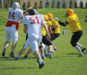american football players running on field