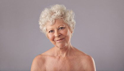 Attractive old woman looking happy