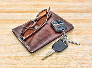 Sunglasses and car keys with leather wallet