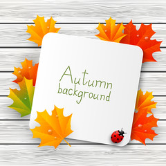 Paper card with autumn leaves