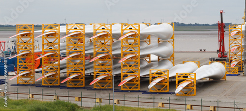 canvas print picture Many rotor blades for huge wind turbines in harbour