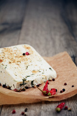 Tasty old peace of cheese on the table