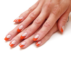 Women's hands with a colored red nail polish isolated