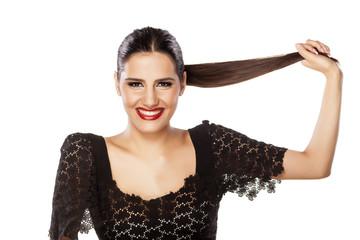 smiling girl holding her hair in ponytail