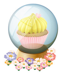 A clear crystal ball with a cupcake inside