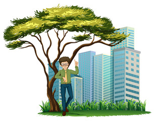 A man standing under the tree across the offices