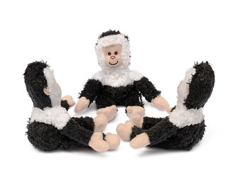 three toy monkeys