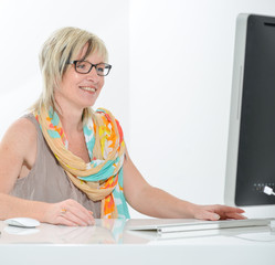 senior beautiful young woman working at office with computer