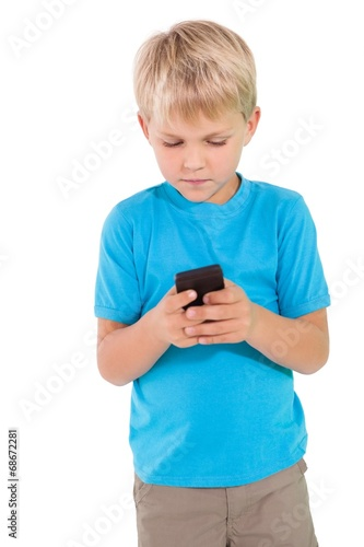canvas print picture Cute little boy using smartphone