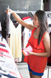 Young woman buys clothes