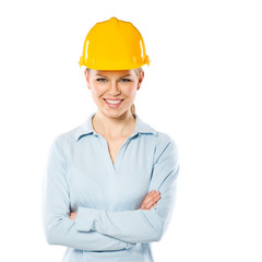 Portrait of smiling woman engineer wearing yellow helmet