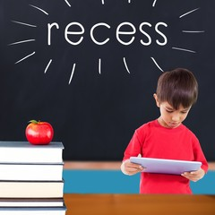 Recess against red apple on pile of books in classroom