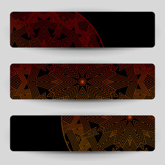 Black banners with red geometric decoration.