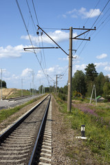 A railway under blue sky with clouds of white