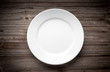 Empty white plate on wooden table - 68675462