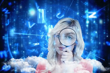 Composite image of woman with magnifying glass