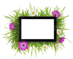 Tablet with blank white screen surrounded by flora