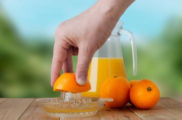 Hand Squeezing Fresh Orange