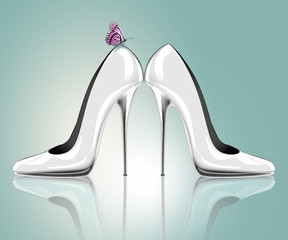 Elegant high heel shoes with butterfly, symbol for wedding