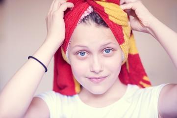 Beautiful happy teen girl with towel on her head