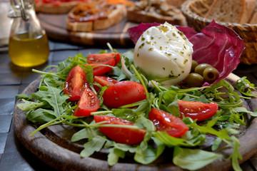 Buffalo mozzarella with tomatoes and arugula salad