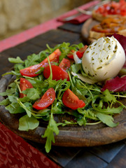 Buffalo mozzarella with tomatoes and arugula salad