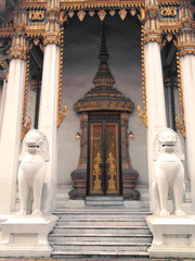 ancient marble lion standing at front of main temple