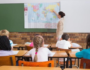 Pupils listening to their teacher at map