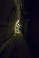 Long corridor view of barrels
