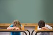 canvas print picture - Sleepy pupils napping at desks in classroom