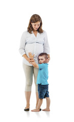 Happy pregnant mother with her son in studio