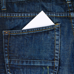 White card in a back pocket of a jeans