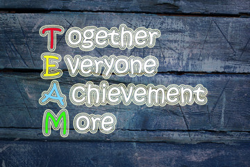 team meaning written on blackboard background, high