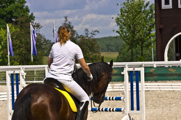 Horse hesitating during show jumping.