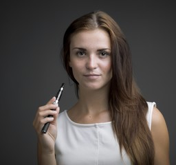 Smiling beautiful woman with ecigarette