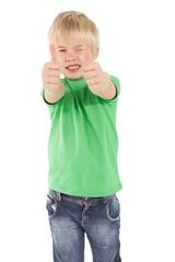 Cute little boy showing thumbs up
