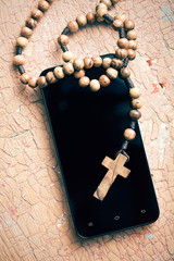 rosary and smartphone