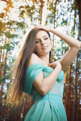 Summer portrait of a beautiful young woman