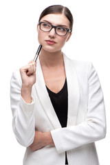 Contemporary business woman thinking and holding black pen
