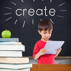 Create against green apple on pile of books in classroom