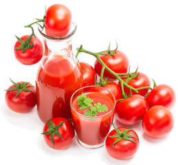 Tomato juice with branch of red tomatoes