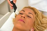 Therapist applying lipo massage  LPG therapy poster