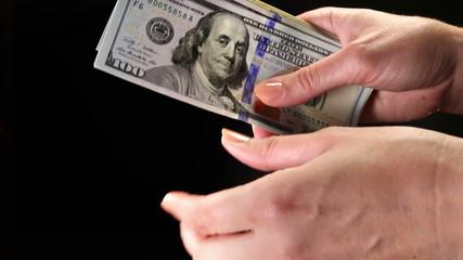Female hand counting dollar money