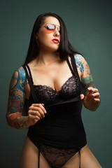 Beautiful girl with stylish make-up and tattooed arms,,..