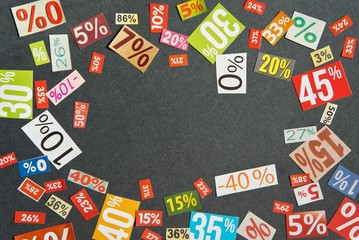 DISCOUNTS background is made up of multi-colored cut out figures