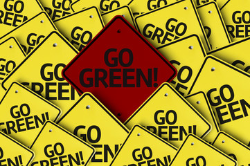 Go Green! written on multiple road sign