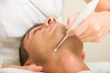 Man getting a face treatment