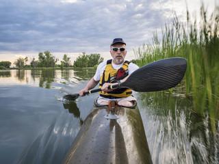 paddling sea kayak on a lake