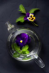 Herbal tea with flowers. Tea with mint  and viola flowers.