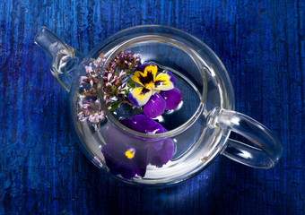 Tea with flowers and herbs. Viola and oregano.